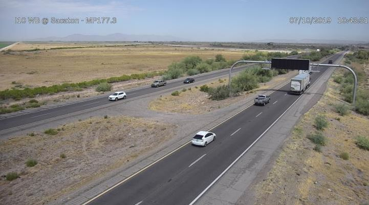 The image shows an image from an Arizona Department of Transportation scanner on Interstate 10. Vehicles drive across a stretch of road through the desert.
