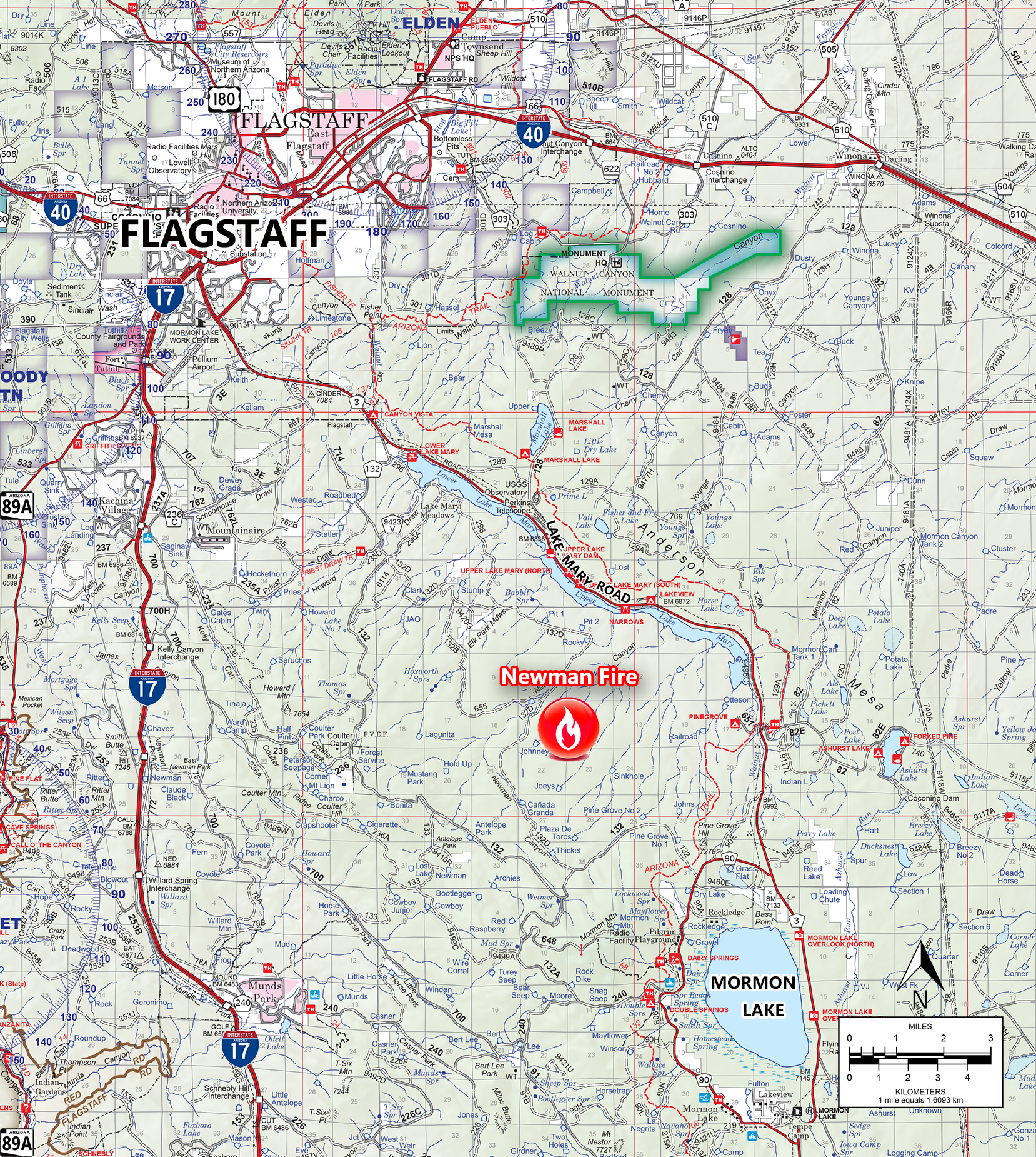 The image shows a map of the Flagstaff, Arizona area. A red fire icon is shows where the Newman Fire is located.