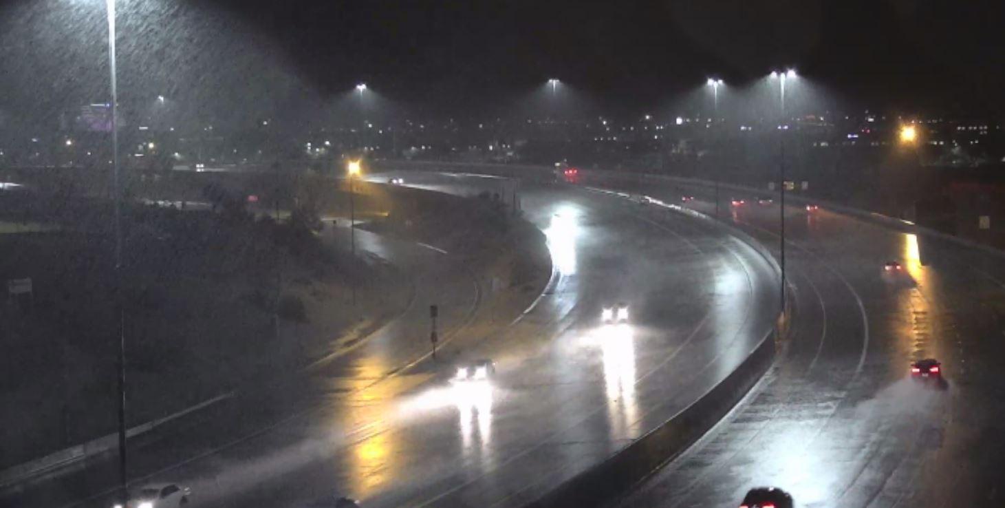 Rain falling on Loop 101 Freeway near Scottsdale