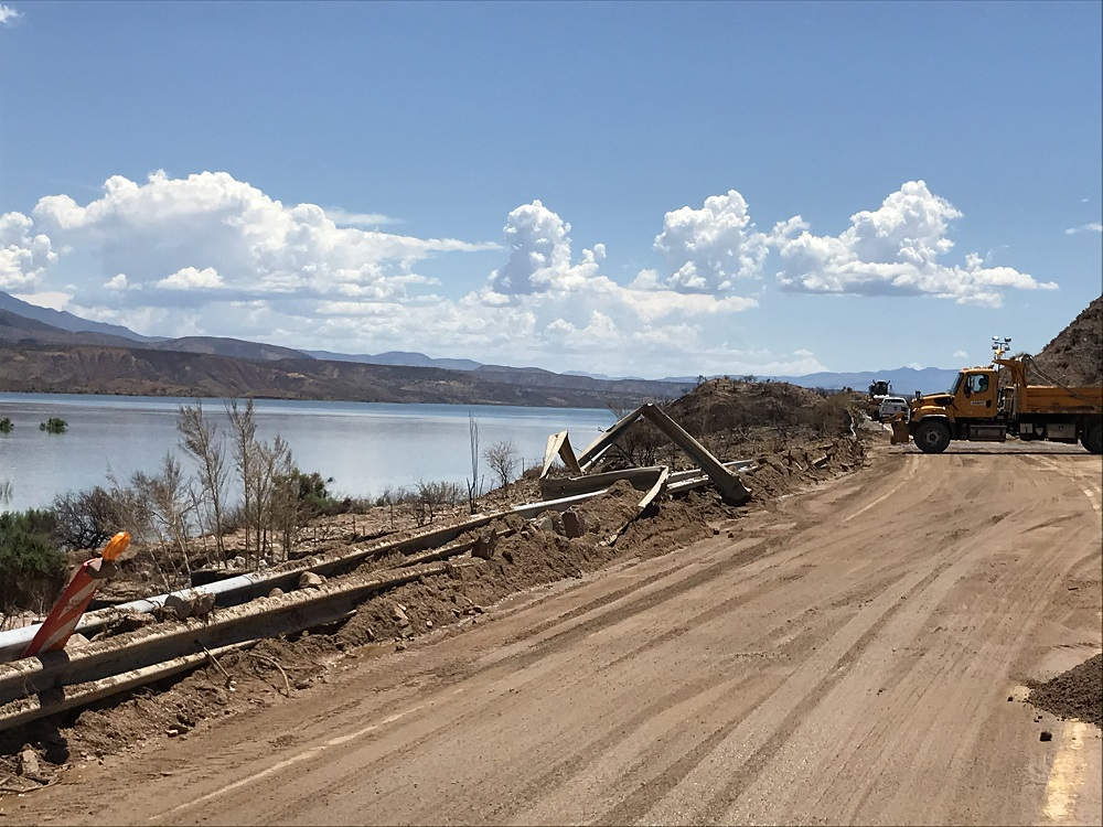 Photo of a guardrail taken out by a mudslide from ADOT